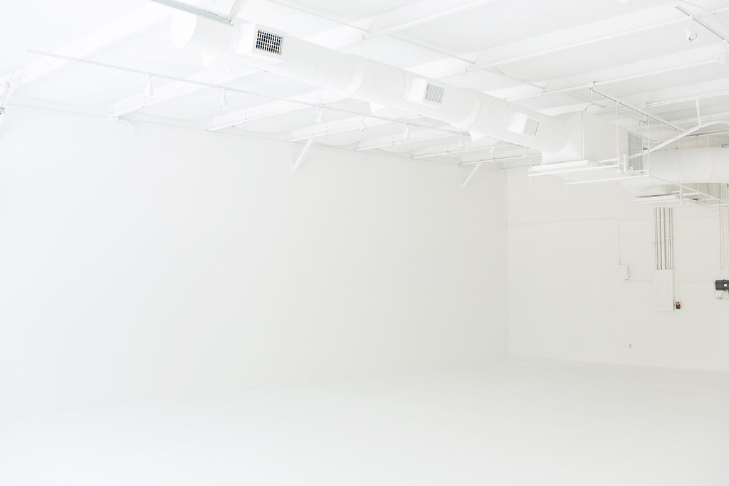 all white back left corner view of photography studio